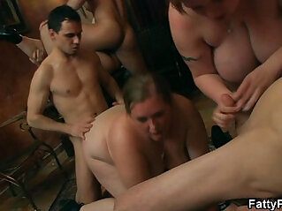 Chubby girl takes on two cocks from both sides