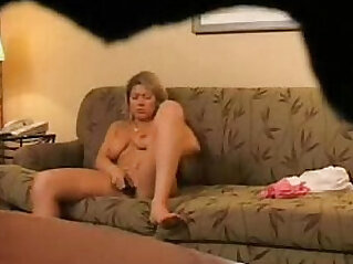 Hidden cam catches my mom home alone masturbating on couch