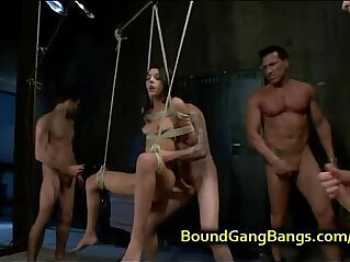 Bound suspended babe in stockings gets double penetrated at stockings niche