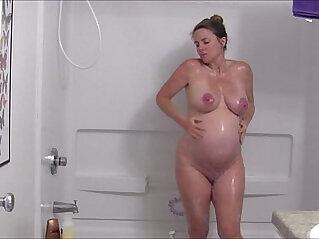 UK pregnant milf showering