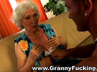 Mature granny face fucked by a large cock