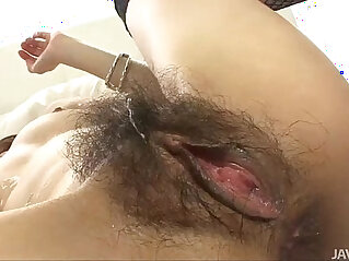 Japanese doll Sara has her furry muff pounded by a hard dick