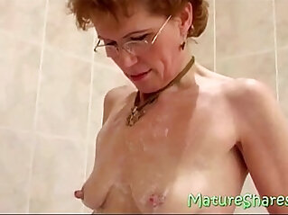 Granny shaving pussy